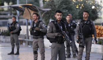 Israeli border guards stand outside Damascus Gate in Jerusalem's Old City following the attack, June 16, 2017.