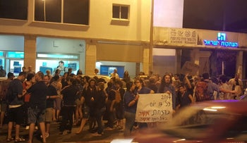 Protesters in Haifa rallying against violence against women, June 17, 2017.