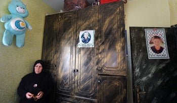 Raed Radeideh's mother, Azaya. Raed's photos are on the closet and door.