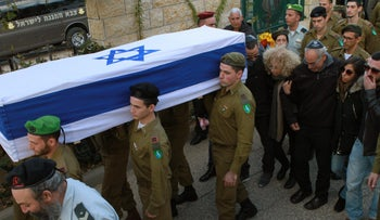 Soldiers carrying the coffin of  Yael Yekutiel as her family walks behind at Kiryat Shaul Military Cemetery, Tel Aviv, January 9, 2017.