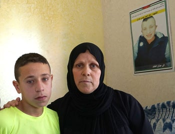 Raed Radeideh's mother, Azaya, and one of his brothers.