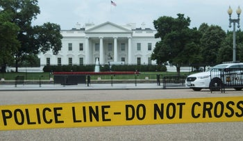 Police tape hangs along Pennsylvania Avenue across from the White House in Washington, DC, on June 15, 2017