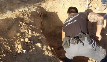 The police searching for the body of 19-year-old Hanan al-Bahiri in the family compound in the Negev, June 2017.