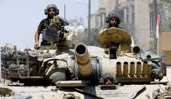 Iraqi soldiers look out from a tank as they advances towards the Islamic State militants positions in the Old City in western Mosul, Iraq June 18, 2017