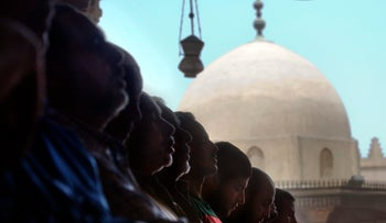 People pray at Amr Ibn Al As mosque, in Cairo, Egypt, Friday, June 9, 2017