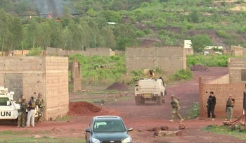 An armored vehicle drives towards Le Campement Kangaba resort following an attack where gunmen stormed the resort in Dougourakoro, Mali in this still frame taken from video June 18, 2017.