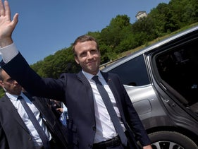 French President Emmanuel Macron waves as he attends a ceremony on June 18.