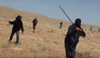 Masked men attacking leftist activists near the outpost of Baladim some two months ago.