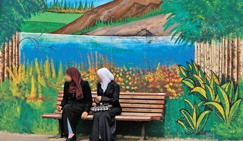 FILE PHOTO: Israeli Arab women sit on a bench in northern Israel (Illustration)