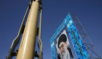 A Ghadr-F missile is displayed next to a portrait of Iranian Supreme Leader Ayatollah Ali Khamenei at a Revolutionary Guard hardware exhibition in Tehran, Iran.