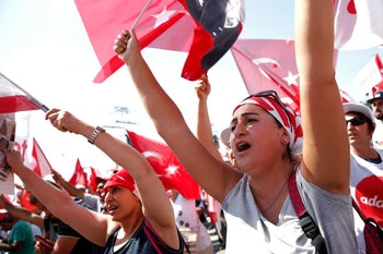 "Supporters of main opposition leader Kemal Kilicdaroglu gather for a rally following the 425-kilometer ""March for Justice"" in Istanbul, July 9, 2017."