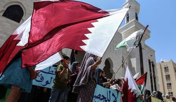 Gazans supporting Qatar near a mosque funded by Doha, Khan Yunis, Gaza, June 12, 2017