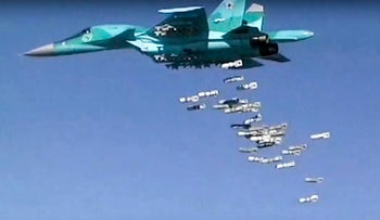 File photo: Still from a video provided by Russian Defense Ministry shows a Russian combat fighter bomber Su-34 unloads its bombs over a target in Syria.
