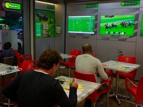 A betting office on Ben Yehuda Street in Tel Aviv, where clients put down money on horses competing in races abroad.