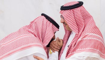 Newly appointed Crown Prince Mohammed bin Salman (L) kisses the hand of Prince Mohammed bin Nayef in Mecca, Saudi June 21, 2017.