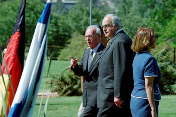This file photo taken on June 06, 1995 shows Israeli Premier Yitzhak Rabin (L) shows the way German Chancellor Helmut Kohl at the end of the official welcoming ceremony at the Rose Garden in Jerusalem.