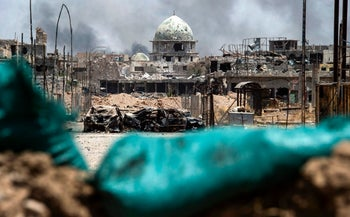 A picture taken on July 2, 2017 shows a general view of a destroyed mosque in the Old City of Mosul, during the government forces' offensive to retake the city from Islamic State (IS) group fighters.