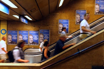 """Hungarian government poster portraying financier George Soros and saying """"Let's not let George Soros have the last laugh"""" is seen at a subway station in Budapest, July 11, 2017."""
