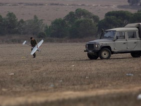 A soldier holds a drone near the Gaza border after the 2014 Gaza war.