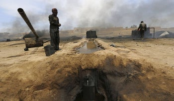 The site of an oil refinery in Syria.