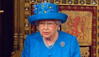 Britain's Queen Elizabeth II delivering the Queen's Speech during the State Opening of Parliament in London, June 21, 2017.