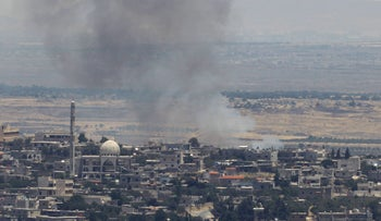 A picture taken from the Israeli-occupied Golan Heights shows smoke billowing from the Syrian side of the border on June 26, 2017.