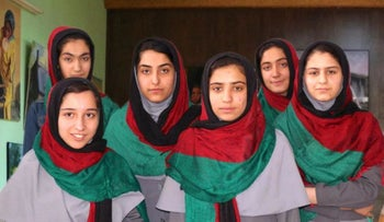 Team Afghanistan pose for a group photo in headscarves featuring their country's colors.