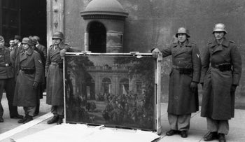 File photo: German soldiers of the Hermann Göring Division posing in front of Palazzo Venezia in Rome in 1944 with a picture of looted art taken from the Biblioteca del Museo Nazionale di Napoli.