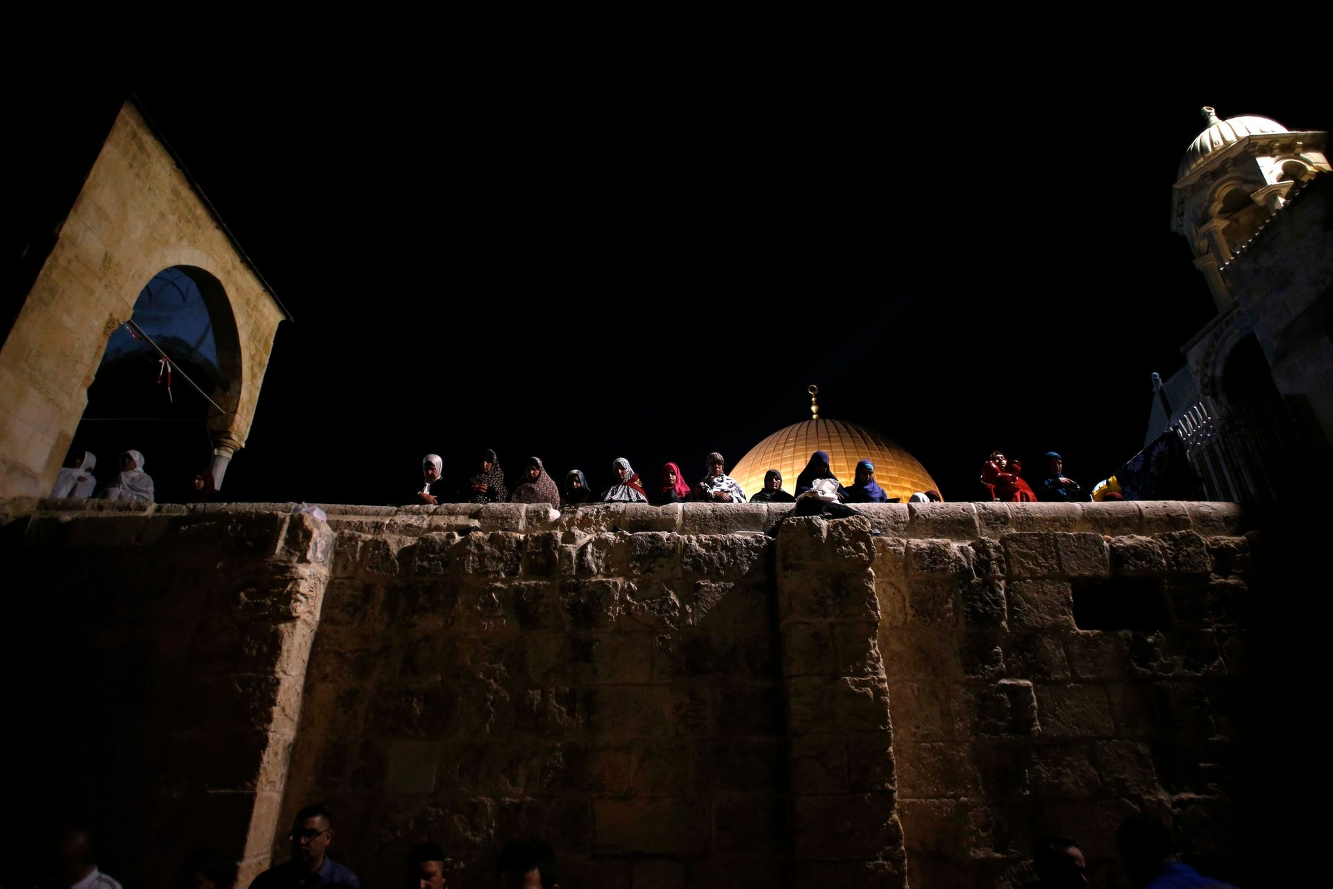 Muslim women pray in front of the Dome of the Rock, during Laylat al-Qadr in Jerusalem's Old City June 21, 2017.