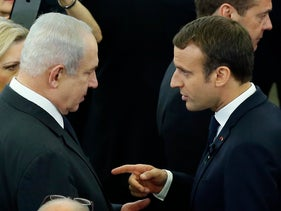 Israeli Prime Minister Benjamin Netanyahu speaks to French President Emmanuel Macron during a memorial ceremony in honor of late former German Chancellor Helmut Kohl, in Strasbourg, France, July 1, 2017.