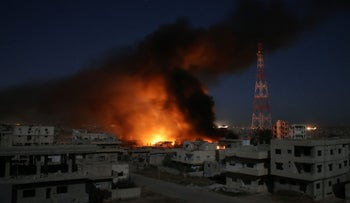 Smoke billows following a reported air strike on a rebel-held area in the southern Syrian city of Daraa early on June 9, 2017.