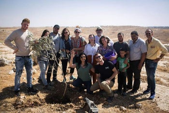 Dorit Rabinyan, crouching in green shirt, and Michael Chabon in back center, with other activists and writers at the tree-planting ceremony.