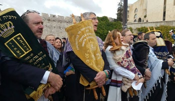 Non-Orthodox rabbis bring Torah scrolls into Western Wall plaza to protest Israel's inaction. Conservative Rabbi Steven Wernick (L), Reform Rabbi Rick Jacobs, Women of the Wall's Anat Hoffman (C), Conservative Rabbi Mauricio Balter, (R) Reform Rabbi Gilad Kariv. November 2, 2016.