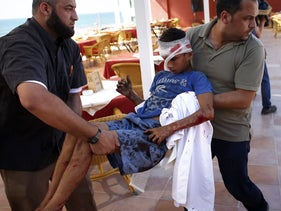 Evacuating wounded from the Israeli missile strike that killed 4 children. July 16, 2014