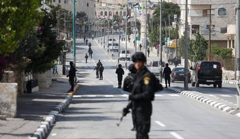 File photo: Palestinian security forces line up the street in Bethlehem, Tuesday, May 23, 2017.