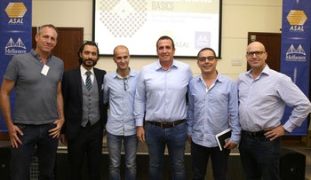 Participants in a Tel Aviv event to introduce Israeli high-tech firms to the advantages of outsourcing projects to Palestinian engineers and programmers.Second from right Murad Tahboub; third from right Eyal Waldman; fourth from right Sari Taha