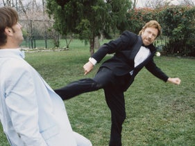 Chuck Norris delivers a roundhouse kick to an unidentified actor in a scene from an episode of the television series 'Walker, Texas Ranger' in 1998.