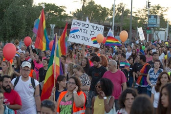 """Hundreds of Israelis march in Be'er Sheva's first gay pride. Sign reads: """"Understand, Be'er Sheva, this how how nature's made me."""""""