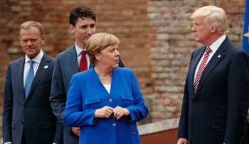 File photo: German Chancellor Angela Merkel with President Donald Trump during a family photo with G7 leaders in Taormina, Italy on May 26, 2017.