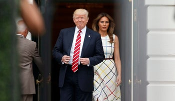 President Donald Trump with first lady Melania Trump, step out of the Diplomatic Reception Room as they arrive at the Congressional Picnic on the South Lawn of the White House, Thursday, June 22, 2017, in Washington.