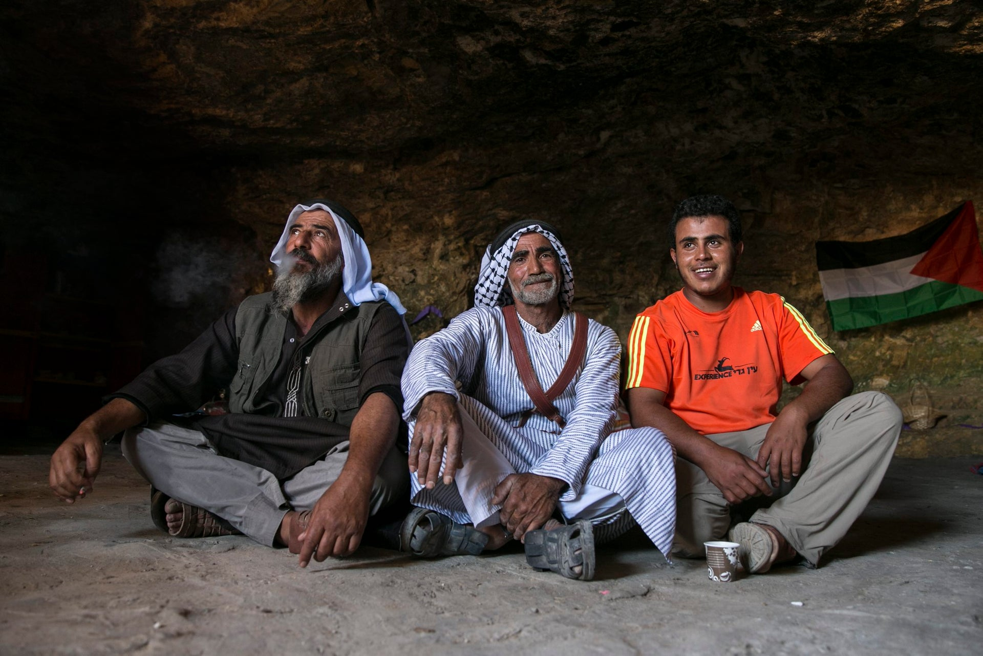 Fadel Amar with Palestinian activists in the cave that was renovated in Sarura, June 2017.
