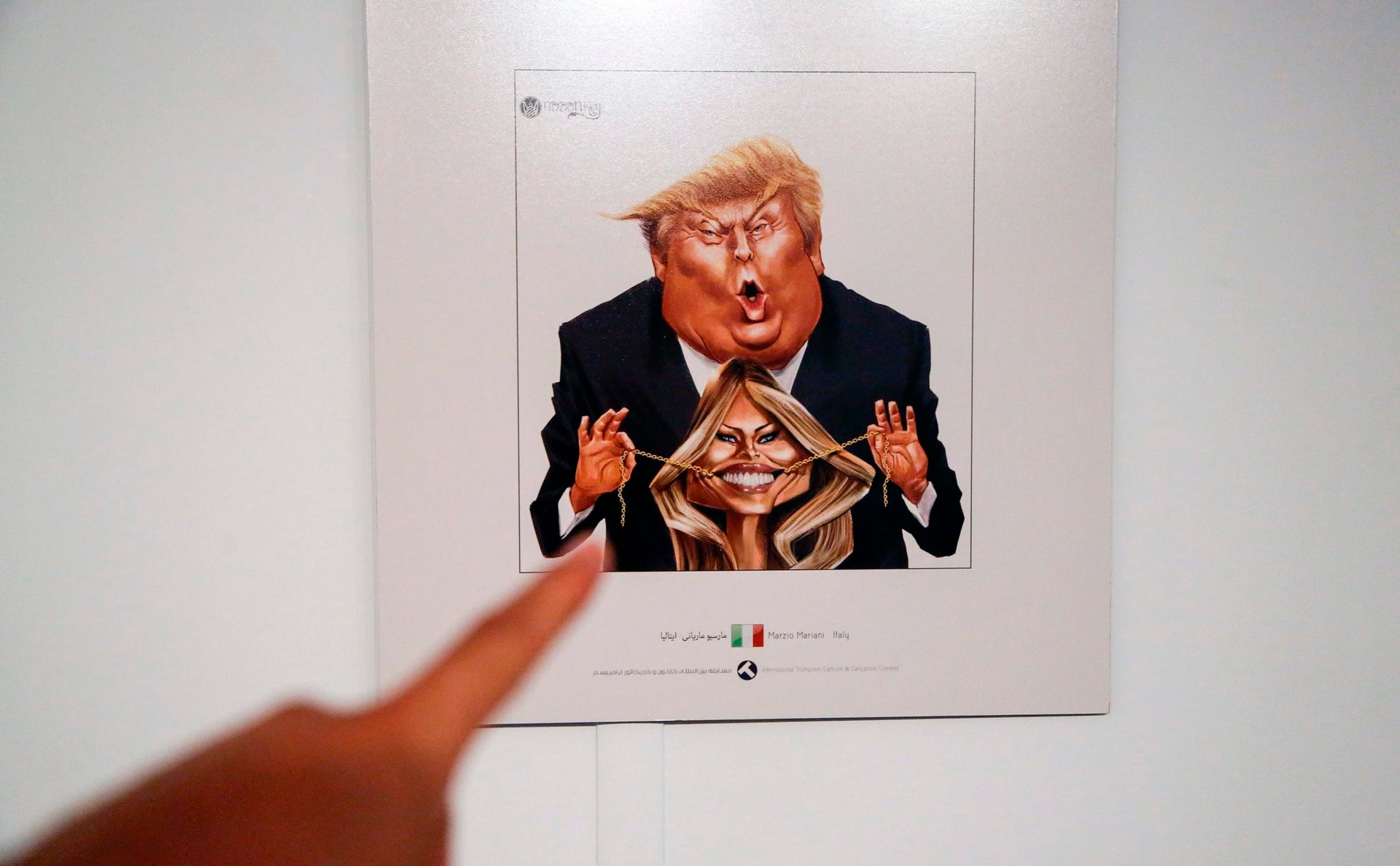 A picture taken on July 3, 2017 shows a cartoon of US President Donald J. Trump and First Lady Melania Trump on display at an exhibition of the Islamic Republic's 2017 International Trumpism cartoon and caricature contest, in the capital Tehran.