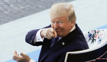 U.S President Donald Trump points to someone as he attends the Bastille Day parade in Paris, July 14, 2017.