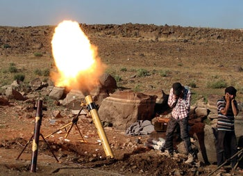 Rebel fighters fire mortar shells towards forces loyal to Syria's President Bashar al-Assad in Quneitra province, bordering the Israeli-occupied Golan Heights, Syria June 24, 2017