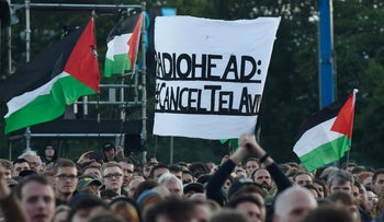 Pro-Palestinian protesters rally against Radiohead's planned concert in Tel Aviv at the TRNSMT music Festival on Glasgow Green, Glasgow, July 7, 2017.