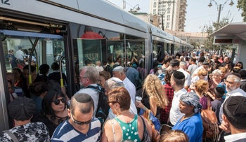 Waiting for the light rail in Jerusalem. The tram platform is crowded to the nth degree. It's not going to get better unless Israel radically changes social policies, argues BGU professor Alon Tal.