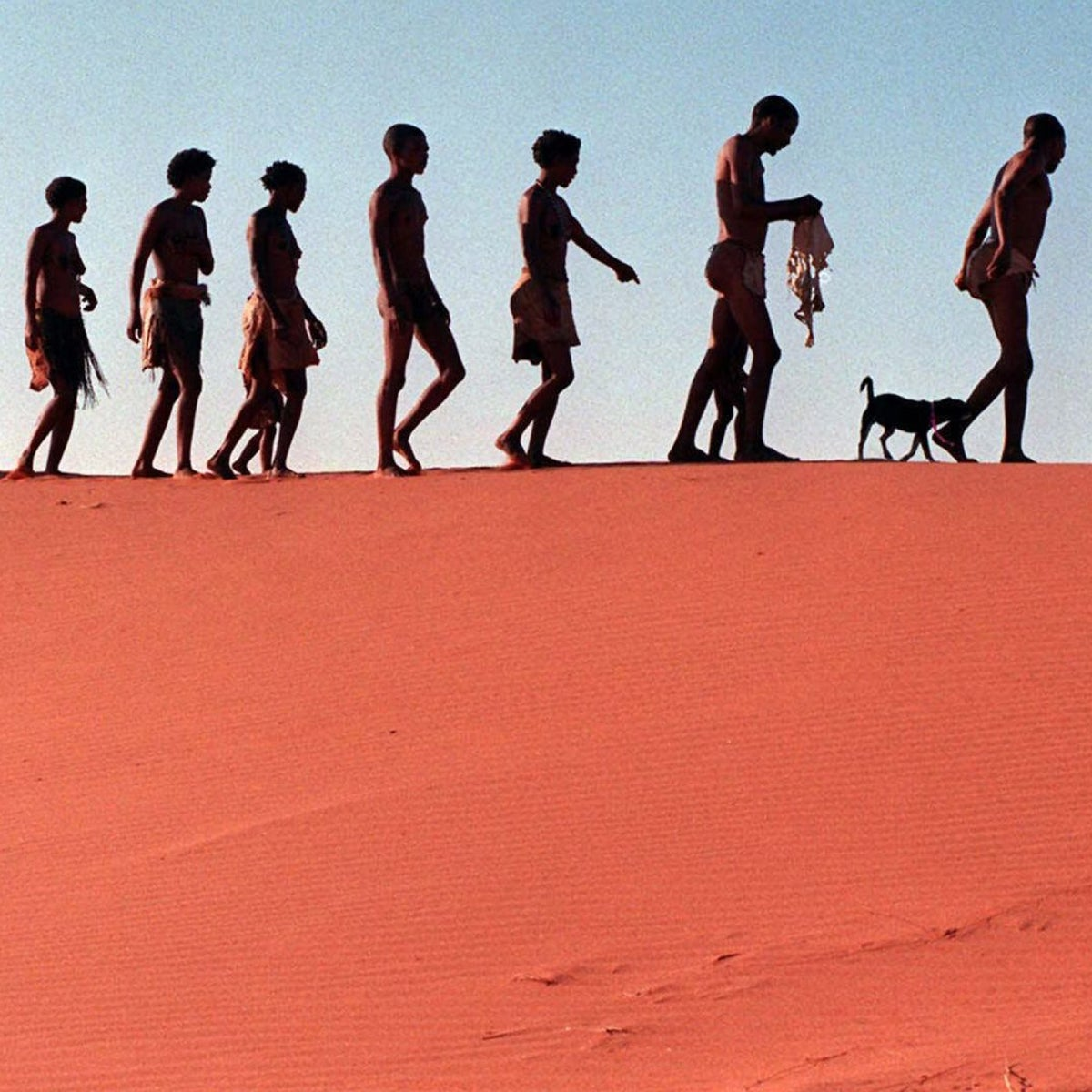 FILE -- In this Jan. 23, 1999 file photo, San people walk on the dunes in the Khomani cultural landscape to visit an ancestral burial site. Africa has several new sites on the United Nations world heritage list, including the Eritrean capital of Asmara, an old royal capital in Angola and a desert area in South Africa that was inhabited during the Stone Age,