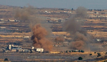 Smoke billows from the Syrian side of the border, Golan Heights, Israel, June 25, 2017.
