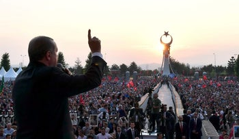 File photo: Turkish President Tayyip Erdogan addresses his supporters during a ceremony marking the first anniversary of the attempted coup at the Presidential Palace in Ankara, Turkey July 16, 2017.