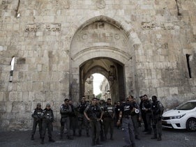 File photo: Israeli border police officers stand guard at the Lion's Gate in Jerusalem's Old City, Monday, July 17, 2017.